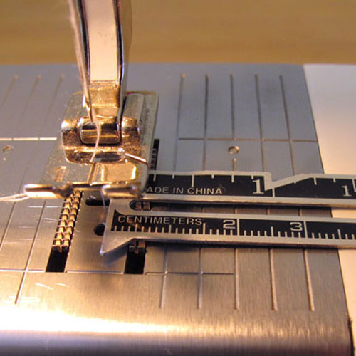 This needleplate is marked with 0.5cm increments